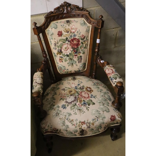 45 - <B>A late Victorian carved walnut upholstered open armchair</b></i>...