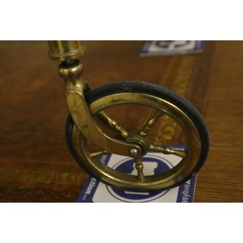 47 - <B>A brass Maison Bagues bar cart, width 75cm depth 42cm height 66cm</b></i>...