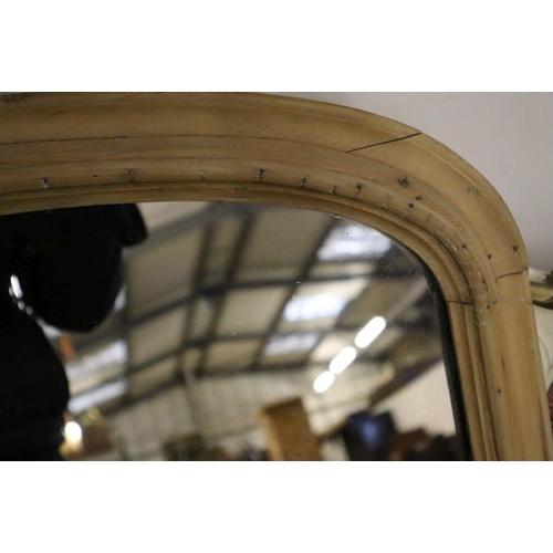 49 - <B>A late Victorian pine overmantel mirror, width 112cm height 65cm</b></i>...