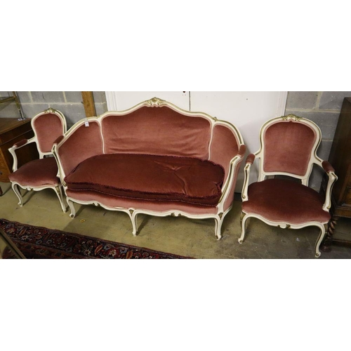 50 - <B>A Louis XV style cream and gilt painted carved wood framed canape and a pair of open armchairs, u...