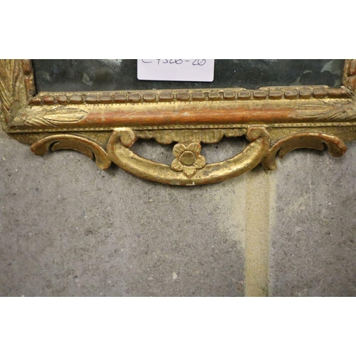 51 - <B>A gilt framed wall mirror, 26 x 51cm</b></i>...