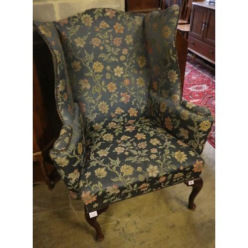 54 - <B>A George I style mahogany framed wing armchair</b></i>...