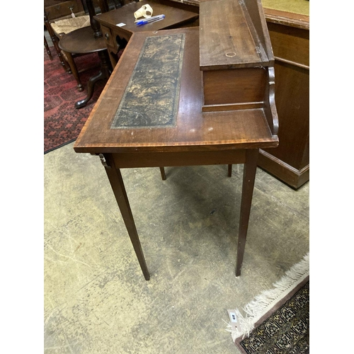 6 - <B>An Edwardian satinwood banded mahogany writing table, width 76cm depth 42cm height 93cm</b></i>...