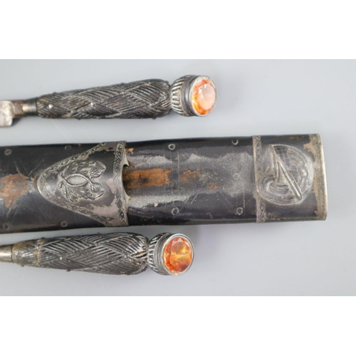 12 - <B>A William IV Scottish silver mounted black leather dirk,</b></i> hallmarks for David Crichton Rai...