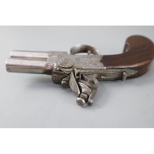 14 - <B>An early 19th century twin barrel flintlock pocket pistol, by Jn. & Geo. Jones of London,</b></i>...