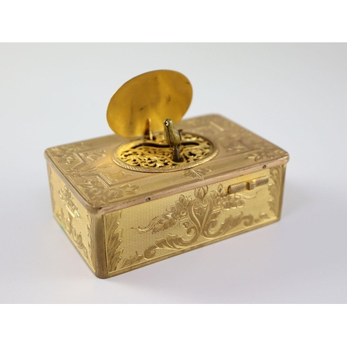 28 - <B>A late 19th century Swiss ormolu singing bird box,</b></i> with flower and scroll engraved case, ...