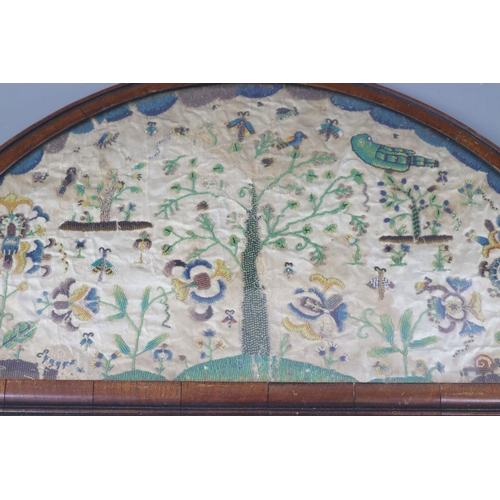 37 - <B>A late 17th century silk and bead work arched panel,</b></i> with central tree, birds, butterflie...