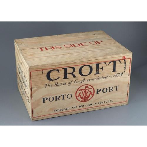 4 - <B>A case of Croft 1975 vintage Port, bottled 1977, original opened wooden crate</b></i> <I>(12 bott...