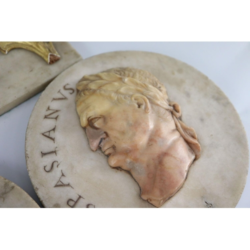 44 - <B>After the antique. A pair of early 19th century Italian marble roundels,</b></i> carved with the ...