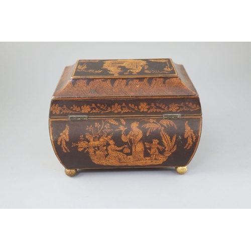 48 - <B>A Regency penwork tea caddy,</b></i> of sarcophagus form, decorated with chinoiserie figures in g...