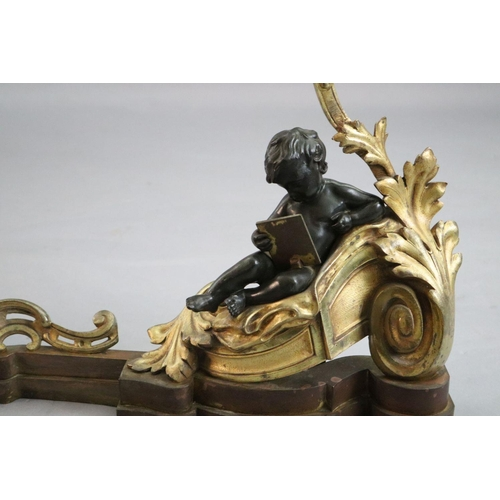 49 - <B>A Louis XVI style bronze and ormolu fender,</b></i> with putto and foliate scroll terminals, <I>l...