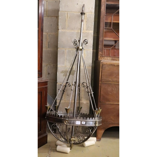 50 - <B>A Victorian steel and brass Gothic style chandelier, with conical brass sconces,</b></i> <I>drop ...
