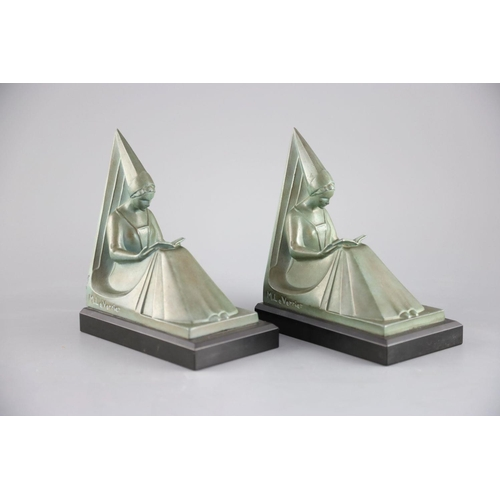 56 - Max le Verrier. A pair of Art Deco patinated bronze bookends, modelled as seated medieval maidens, s...