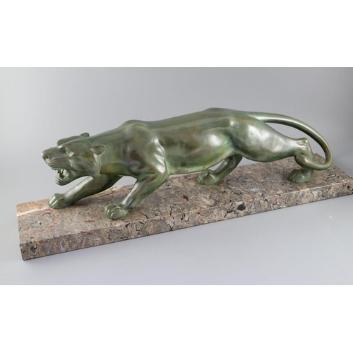 57 - <B>Brault. An Art Deco patinated bronze model of a prowling panther,</b></i> with light green brown ...