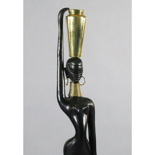 60 - <B>Karl Hagenauer. A brass and ebonised bronze figure of an African water carrier,</b></i> with vase...