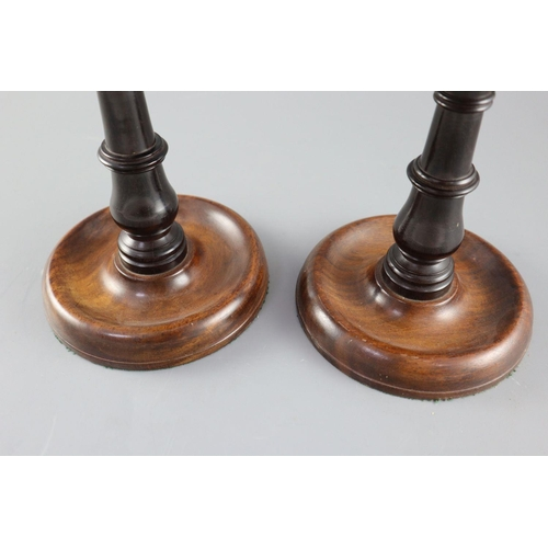 8 - <B>A pair of George III mahogany and ebony adjustable candle stands,</b></i> with telescopic stems <...