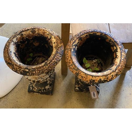 1004 - A pair of Victorian cast iron campana shaped garden urns, height 32cm