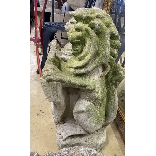 1032 - A pair of reconstituted stone lion and shield garden ornaments, height 56cm
