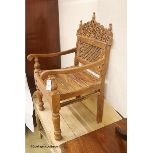 9 - An Anglo-Indian carved hardwood elbow chair, width 55cm, depth 48cm, height 98cm