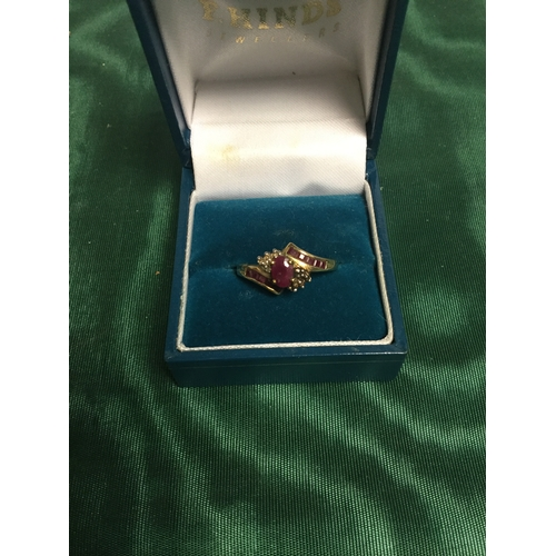 2 - A 9ct gold ruby set dress ring -...