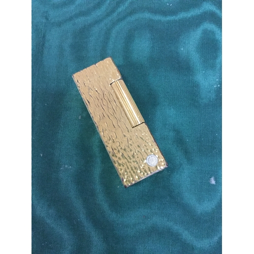 10 - A gold plated Dunhill lighter -...