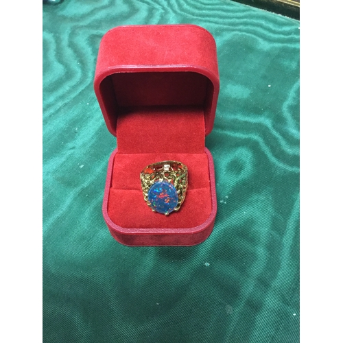 14 - A 14ct gold ring, the textured and pierced band set with a large black opal doublet -...