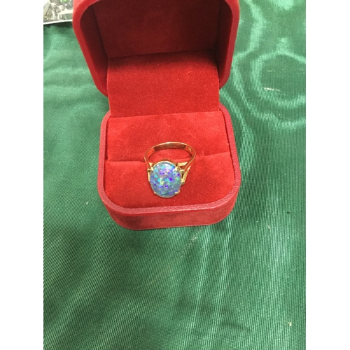 15 - A 9ct gold ring, set to the front with an oval opal (possibly doublet) -...