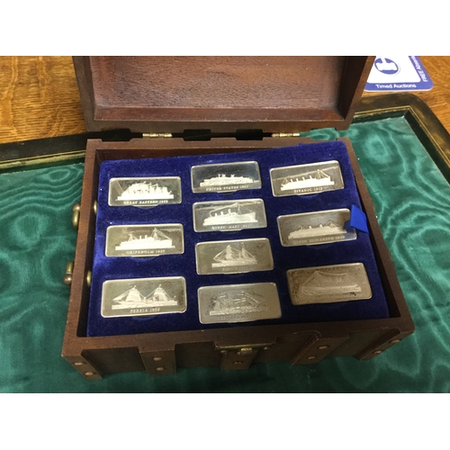 18 - A group of eleven silver commemorative ingots, each with famous ship, contained in faux treasure che...
