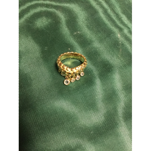 30 - An unusual yellow metal ring, stamped 750 + 18k, the textured band suspending rose cut diamonds -...