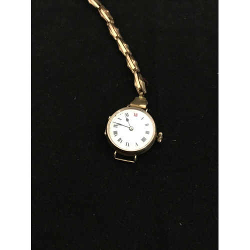 3 - A lady's 9ct gold cased wristwatch,  to rolled gold strap -...