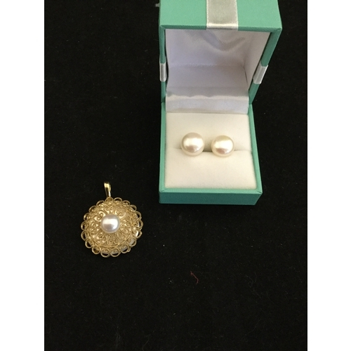 29 - A 9ct gold and pearl pendant,  together with a pair of gold mounted pearl studs -...
