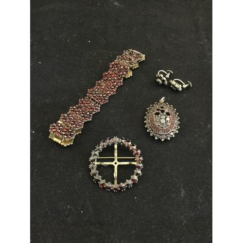 51 - A Bohemian garnet panel bracelet,  together with similar locket, brooch and earrings -...