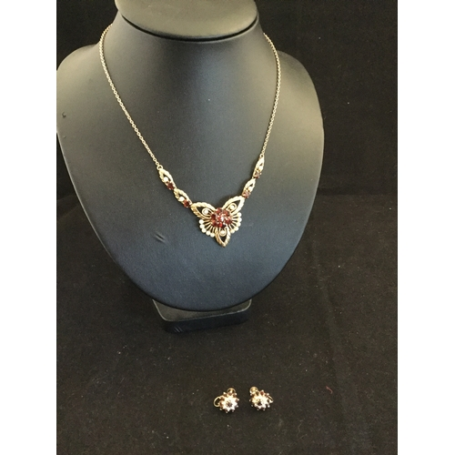52 - A 9ct gold garnet and pearl set necklace  and pair of matching earrings with screw backs -...