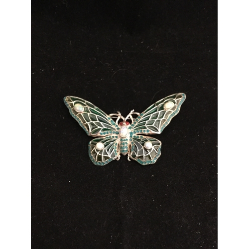 59 - A modern silver and plique a jour enamel brooch,  designed as a butterfly with opalite and gem set d...