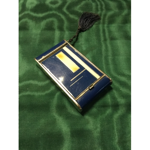 11 - A vintage Princess compact,  with mirrored interior and lipstick slide -...