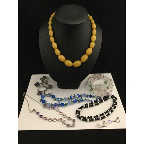 7 - A group of vintage bead necklaces  and a pair of ear-pendants -...