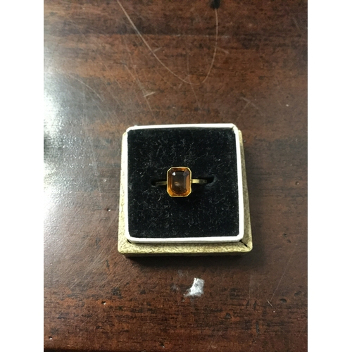 8 - A 9ct gold ring,  set with a rectangular citrine -...