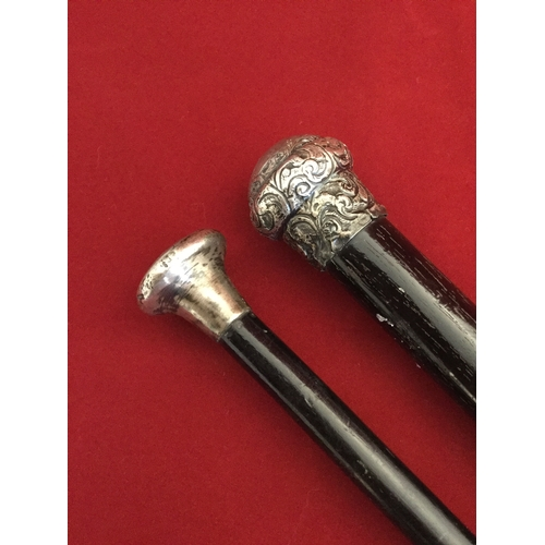 13 - Two silver topped walking canes -...