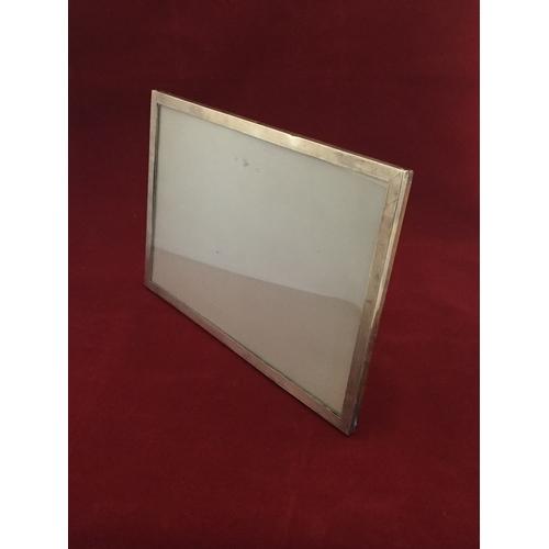 14 - A silver framed easel back photograph frame -...