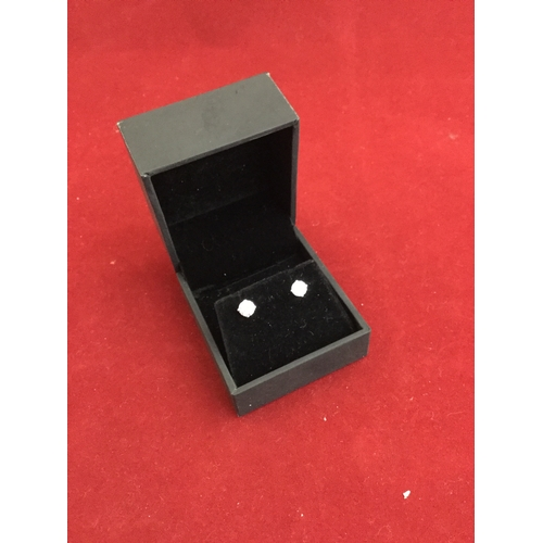 18 - A pair of diamond earstuds,  of approximately 0.9ct total, in 14ct white gold -...