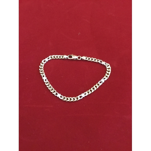 21 - A 9ct gold bracelet,  of flattened curb links -...