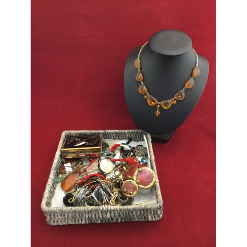 25 - A polished amber bead necklace,  together with assorted costume jewellery, compact etc -...