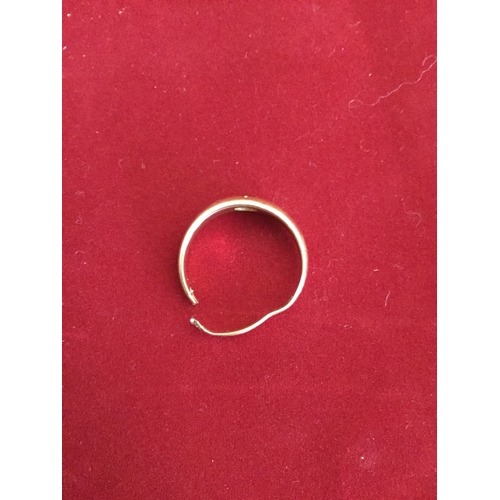 30 - An 18ct gold ring,  gipsy set with a ruby (a/f) -...