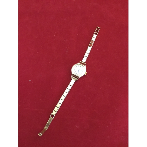 33 - A lady's 9ct gold cased wristwatch,  signed Record, to 9ct strap -...