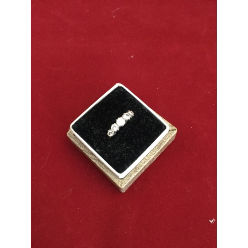 35 - A diamond five stone ring,  set with graduated old cut diamonds to yellow metal mount -...