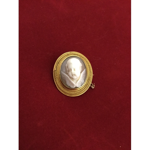 36 - A Victorian shell cameo brooch,  carved in high relief with an angel's head, to yellow metal frame -...