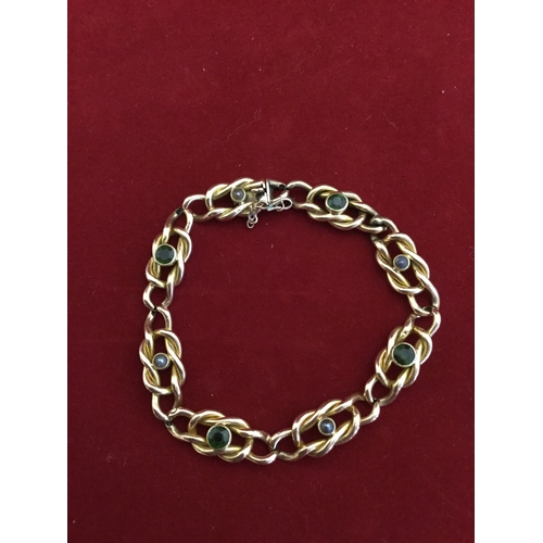 43 - A 15ct gold bracelet,  composed of openwork links alternately set with seed pearls and tourmaline -...