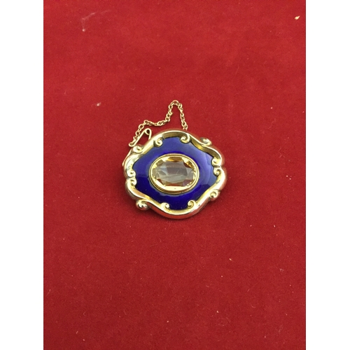 45 - A 19th century gold, enamel and citrine mourning brooch,  with oval citrine with a blue enamel borde...