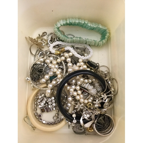 60 - A small quantity of mostly costume jewellery,  including early 20th century carved ivory bangle -...