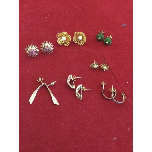 3 - A pair of 9ct gold and ruby earrings,  together with assorted other pairs of earrings, some 9ct some...